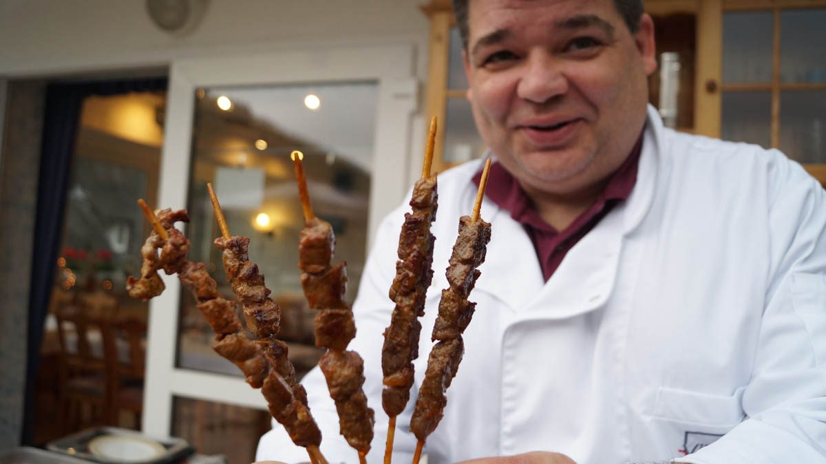Rainer Luy with grill skewers